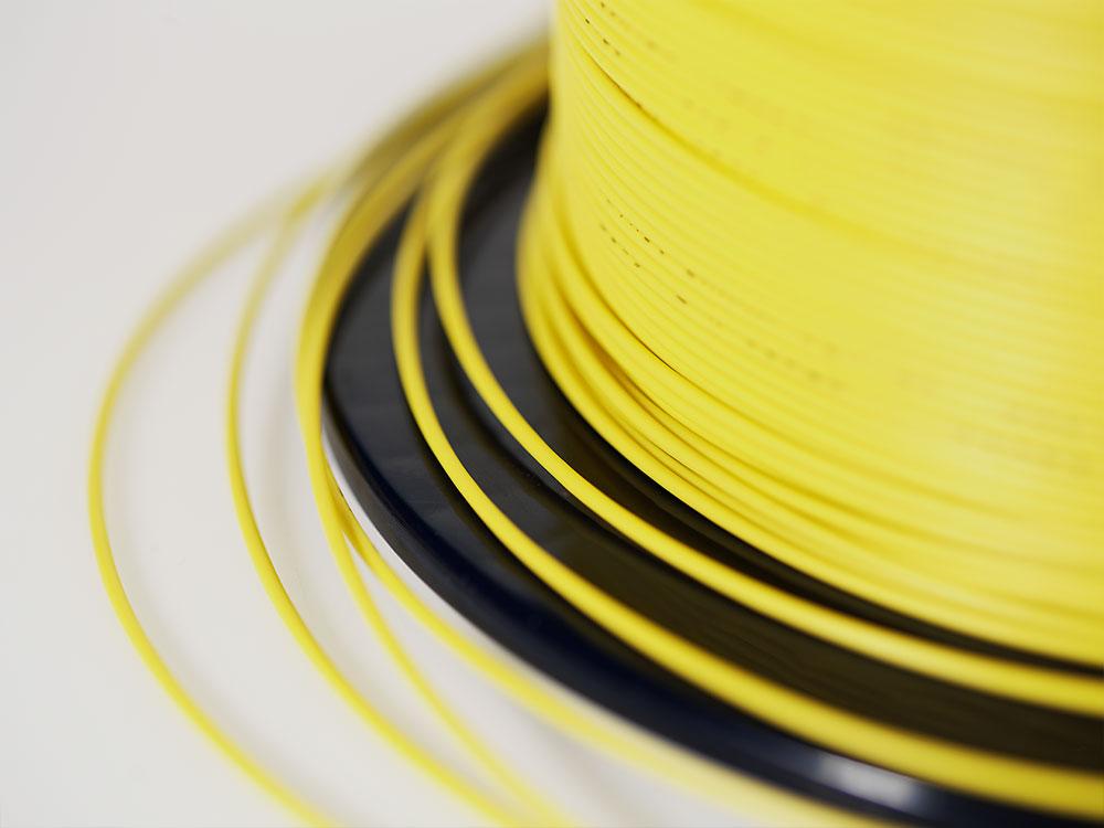 Ralas gula fiberkabel trumma